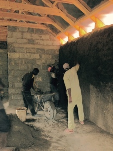 Plastering of the walls.