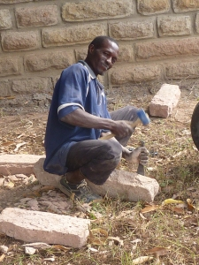 Stone being handfaced by chiseling