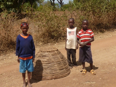 The Children of Kakyanuni watching construction of the Team/Training House