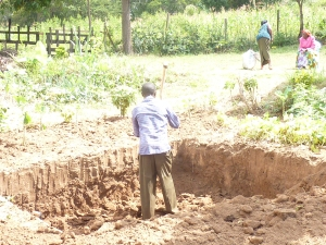 Hard work digging (by hand) the Hole for the platform of the Water Tank Tower.